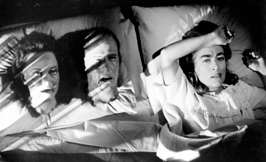 Lucy Harbin (Joan Crawford) waking up with models of severed heads in her bed.