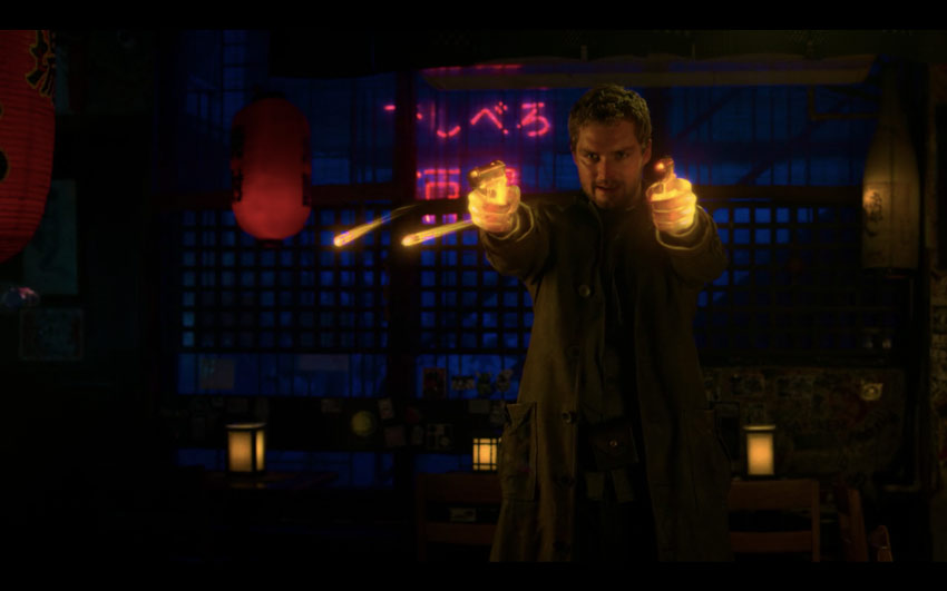Danny Rand imparting the power of the Iron Fist upon two .45mm bullets