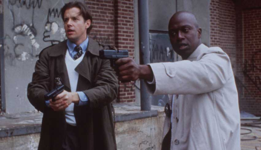 Tim Bayliss (Kyle Secor) and Frank Pembleton (Andre Braugher) in <em>Homicide: Life on the Street</em>.