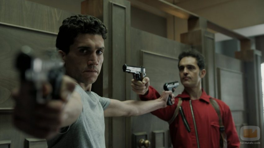 Berlin (Pedro Alonso) and Denver (Jaime Lorente) point guns at each other in Money Heist.